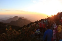 I'm hardly alone on Guangming Peak trying to catch the days last rays.