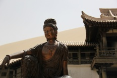 A Bodhisattva watches over her temple.